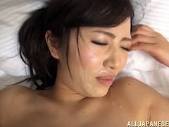 Her pussy was hairy and it was served with a good fingering. This Asian hottie gets fucked doggy style in bed and loves to receive a cumshot in the mouth.