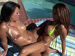 Awesome chicks Francesca Le and Kayme Kai, wearing bikinis, are having lesbian fun outoodrs. The girls oil and lick each other's tits and holes, then sit down on the ground and practise scissoring.