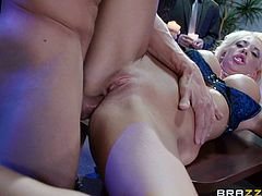 Make sure you take a look at this hardcore scene where the sexy blonde Courtney Taylor is fucked by two guys in a hot threesome.