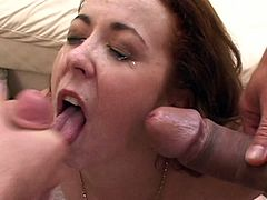Redhead in MMF threesome wearing thong and miniskirt gives blowjob and handjob then gets anal and pussy fucking before taking cumshot facial