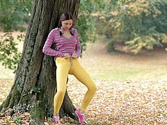 This brunette cutie finds a nice tree to relax. The pigtailed beauty lifts up her shirt to reveal her soft, natural breasts when she thinks no one is looking. she slides her hands down into her yoga pants and rubs her wet pussy. Soon her pants are half way down her legs.