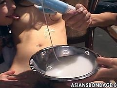 Some kinky Japanese sluts are playing dirty BDSM games in a basement. One of the lesbians, wearing panties, gets tied up to a chair. She gets her snatch toyed and smeared with some white sticky stuff.