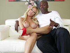 Lexington Steele and Capri Cavanni are having a conversation in CMNF clip. The blond bombshell shows her big fake tits for the camera and shows the tattoo on her belly to Steele.