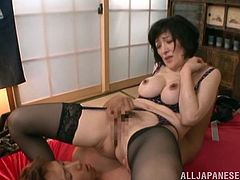 Entertain yourself by watching this Asian cougar, with natural boobs wearing a thong, while she gets pounded hard in different positions.