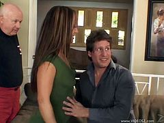Brown-haired bitch Kylee King is playing dirty games with a guy in the living room. She sucks and rides the stud's boner ardently and doesn't pay attention to two men, watching them.