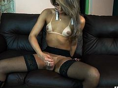 This transsexual has an amazing looking ass. she shakes her booty and flashes her strong, thick cock. she lays back and masturbates herself until she is so close to blowing her cum. she looks hot wearing garters and showing off her tanlines. Watch her jizz.
