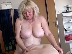 Two big-breasted fair-haired women are having a good time together. The lesbians caress each other on a sofa, then play with each other's big natural boobs and throbbing cunts.