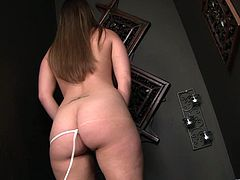 The gorgeous babe Katie Karson gets her filthy mouth filled with hot cum after sucking a big hard cock through a gloryhole.