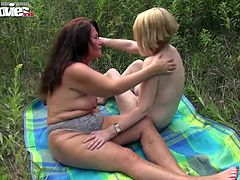These two horny mature lesbians want to cum off each other outdoors! Licking and fucking each other´s pussy till they cum!!