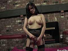 Sexy brunette Julie, wearing stockings and thong, shows her butt for the cam and begins to stroke her body. Then she fingers her pussy and drills it with a dildo.