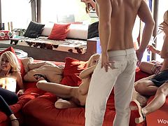 This hunk has a bunch of girls over at his place for a party. They are all out on the balcony having a drink, and when they come inside they want to see their host naked. He takes off his shirt and this amuses the sexy girls, but now they tell him to take his pants off, too.
