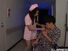 Marvelous Asian nurse with long hair in miniskirt drives her patient on a wheelchair to a room and award him with a superb blowjob