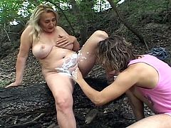 Hairy blonde MILF with huge tits gets some hardcore fucking in the forest.