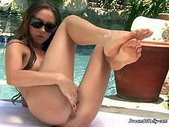 Horny Slut Fingers Her Pussy By The Pool