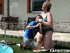 This big woman is forcing this skinny dude to keep his face between her massive jugs and then she undresses him and her. Next, she sits on his face and has fun.