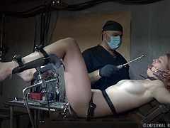 Tied on the gynecologist table Ashley lives a nightmare! The insane doc has perverted thoughts with her and he puts them to action. He gaped Ashley's pussy really hard with a metal speculum and then inserted a device deep inside it. Ashley can't even scream as her mouth is kept opened by metal clamps. Oh yeah!