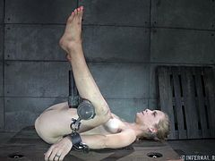 Watch as this unlucky slave is wrapped up tightly with cloth around her feet. She has clamps and chains attached to her nipples, and when the master pulls on them it hurts her a lot. With a gag in her mouth the master prods at her pussy. She drools as she endures the pain.
