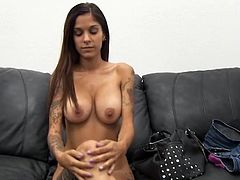 Inked amateur with fake tits sucks cock lustily