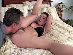 The legendary Penny Flame shows off her ass and kisses her man's neck. She gets on to the bed and her buries his face into her cooch and gives her cunnilingus. She wants to return the favor, so she sucks his cock.
