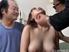 This is an Asian porn scene with two cocks fucking one shaved pussy hardcore doggystyle in orgasm.