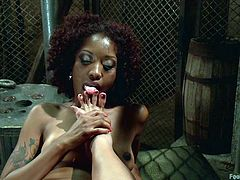 Asian mistress Mia Li is showing her ebony slave Daisy how things are done. She whips her and then licks the soles of her sexy feet. Daisy opens her legs wide so mistress can eat that wet cunt, but there's more. Daisy gets foot fisted and must lick her cum off of the mistress' toes.
