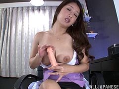 Amazing Asian solo model with natural tits in bra gets cozy and start masturbating passionately using a huge sex toy indoors