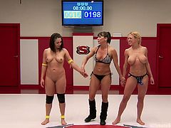 When these two wrestlers get in the ring with each other we find out that the blonde is much stronger than the brunette is. The blonde lesbian has the brunette pinned down for most of the match. The loser gets her face licked and a strap on dildo shoved down into her throat. She lost so she has to take it.