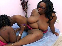 These two big ebony lesbians gets down to some hot pussy eating in this free hardcore sex video.