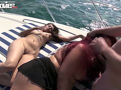 Lusty dirty sluts please one horny stud on the boat