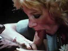 Classic blond prostitute sucks juicy cock with clothed eyes