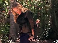 Dyanna Lauren is caressing her sophisticated body outdoors, in the garden. She doesn't expose her pussy, but she touches herself.