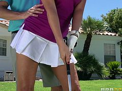 This dirty instructor want to help this busty golfer out with her swing, but he really has something else on his mind. She bends over to pick up her ball and he gets a look at her nice panties. Soon they are fucking on the green. They kiss and she sucks him off.