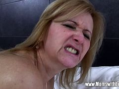 This blonde cougar takes the cock of this young man in all her holes. She is crazy about him and so anxious for him to touch her and drill in every hole she's got.