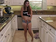 Natasha Malkova looks cute and so innocent. She strips off her pajamas and starts playing with her young snatch while sitting in the kitchen completely naked.