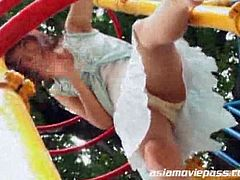 This Asian girl poses in a child park and then she masturbates with a vibrator. More than six guys bang her and cum on her face. She eats the cum at the end.