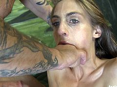 Gianna Michaels gets her face fucked really hard. She can't take all of his cock in her mouth, so he spits her and slaps her face.