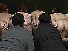 Restrained asian babes getting asses rimmed by horny men