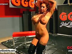 This wild redheaded slut from Germany has big boobs and lots of tattoos on her. She gets fucked hard and jizzed all over her face, hair and in her mouth in a gang bang.