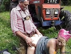 Girl fucks old man on a tractor