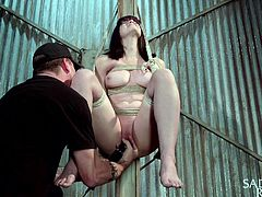 Katt's horny pussy is fingered deep as the bitch is tied up in a fierce rope bondage, with no possible way out from the dark basement. With one hand on her throat, the merciless executor uses a vibrator to bring lusty pleasures. Watch the redhead treated with brutality while her nipples are pinched!