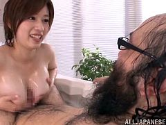 Saki Okuda is fucked by a mature Japanese man. She enjoys sucking it for a hot blowjob inside the bath tub.