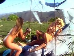 Winsome cowgirl with fake tits giving huge dick blowjob before getting her pussy pounded hardcore in a threesome sex outdoor