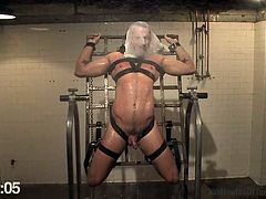 This gay slave hunk is tied up by his master and has a plastic bag put over her face. The slave is contained in a device and has water poured all over him. The water drips down off of his cock. In the next scene, the slave has chains around his neck and he jacks it as he sits on a sybian.