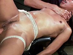 This ebony slave gets tied up by her master and has her pussy pounded with stiff cock. The slave is tied in rope and has a vibrator used on her pussy. The bitch gets a cock in her mouth and choked like a slut.