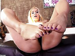 Blonde Brandy Smile does her best to make your cock harder in solo action