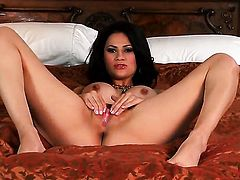 Vanessa Veracruz with gigantic boobs and bald pussy parts her legs to fuck herself with sex toy