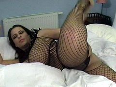 Chubby Brunette In Fishnet Displaying Her Big Booty