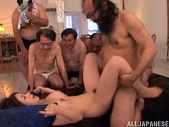 She has signed up for a bukkake where creepy old men lines up to plow her and cum on her pretty Japanese face. She takes it hard as the men jack off and blow their sticky loads all over her face.