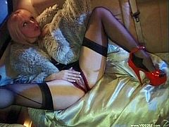 Attractive lesbian in high heels masturbating before getting her pussy being worked on immensely using huge toy in close up shoot