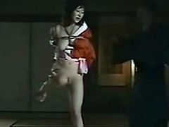 Tied and Suspended Asian teen gets spanked and whipped